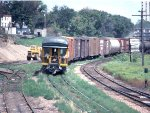 1058-14 Eastbound C&NW freight passes site of recent Burdick #1 and #2 grain elevator fire next to MILW Bass Lake Yard
