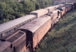 1072-37 MILW slug set couples onto eastbound freight at Cedar Ave Junction