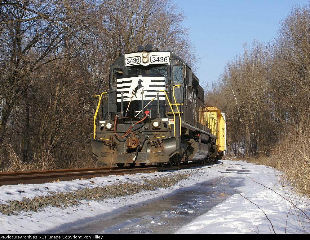 NS 3436 leads 4 freight cars out of town