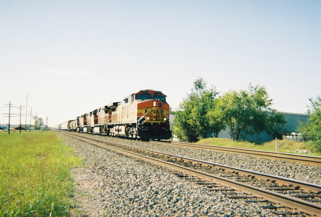 BNSF 4409 leads a high priority manifest past 4th St. in Moore, OK.