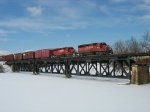 X500 crossing the snow covered Thornapple River