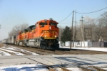 BNSF 9357 has FEPX loads in tow