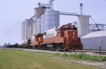 ICG 9609 & 8175 are n/b passing one of the many grain elevators on the line,