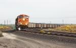 BNSF 5753 hustles a coal train West.