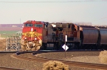 BNSF 4707 heds up a WB grainer.