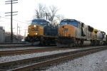 CSX 542 passes 4755 while charging by with the Q438