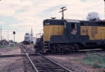 1067-19 Northbound CNW freight on ex-M&StL crosses CNW east-west line
