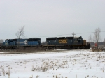 CSX 8055 & 8667 rolling along at a country crossing