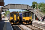 Class 150 units cross at Maiden Newton on Bristol - Weymouth Sevices