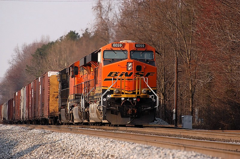 NB ns 118 following 172 slows to enter linwood with some new BNSF untis