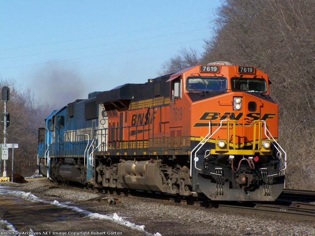 A Fairly new GE Evolution Series and a pair of EMDX SD60s Lead Iron Ore Toward Town