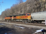 Two Dash-9's Lead a Grain Train Past the Bluffs Along the Mississippi on the Way to LaCrosse, WI and Points North