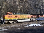 BNSF 4322 Moves Along Past the Dormant Trees and Rocky Bluffs