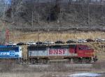 BNSF 155 Roars Past a New Car Dealership Cut into a Cliff