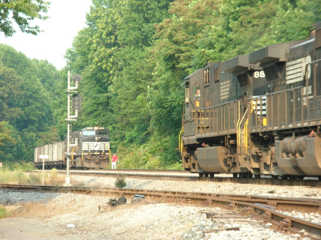 NS trains meet, roll by inspection