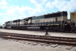 Ex-BN SD70MACs wait to depart with a westbound coal train