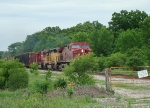 CP 9575 leads a couple of classic EMDs through the greenery near River Road