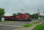 CP 8652 on a westbound stacker blasting across Union Street