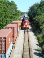 CP 8838 with 199 meets eastbound 198 in the drink