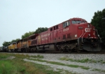 CP 8535 heads another colorful consist on a cloudy day