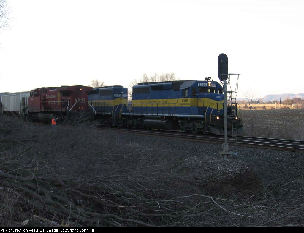 07031732 Eastbound ICE train meets westbound CP train at East Midland with CP power run-around to rear of its train