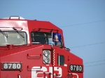 """070919005 Eastbound CP freight with """"Vikings"""" flag waits for CP steamer 2816 in siding"""