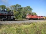 """070916025 Westbound CP 2816 meets eastbound with """"Red Barn"""" at Dickinson Siding"""