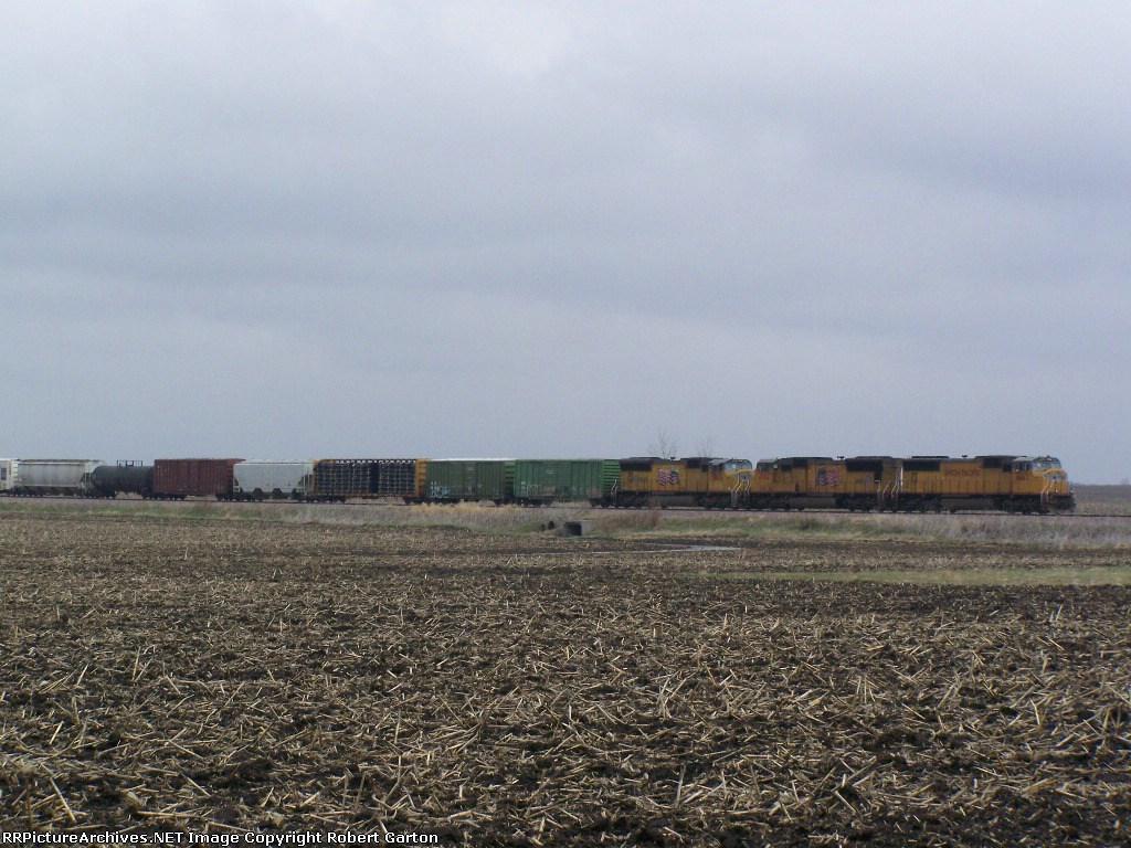 A Long Freight Train Sits on the Mason City Sub