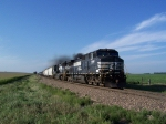 A South-bound BNSF Mixed Freight Prepares to Blow Through a Country Crossing