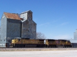 UP 9250 & UP 4750 Sit By the Old Grain Elevator