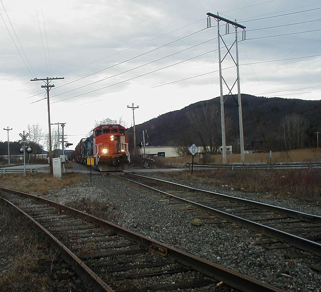 NECR train rolls thru crossing