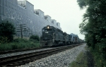 CR  GP-40 3002 (Ex-PC) leads an Eastbound train behid Harris Steel plant, New Brunswick Avenue, So. Plainfield NJ