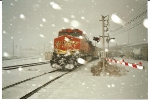 A snow covered BNSF 5975 rolls thru Carlin Junction in a snow storm as a rear DPU.