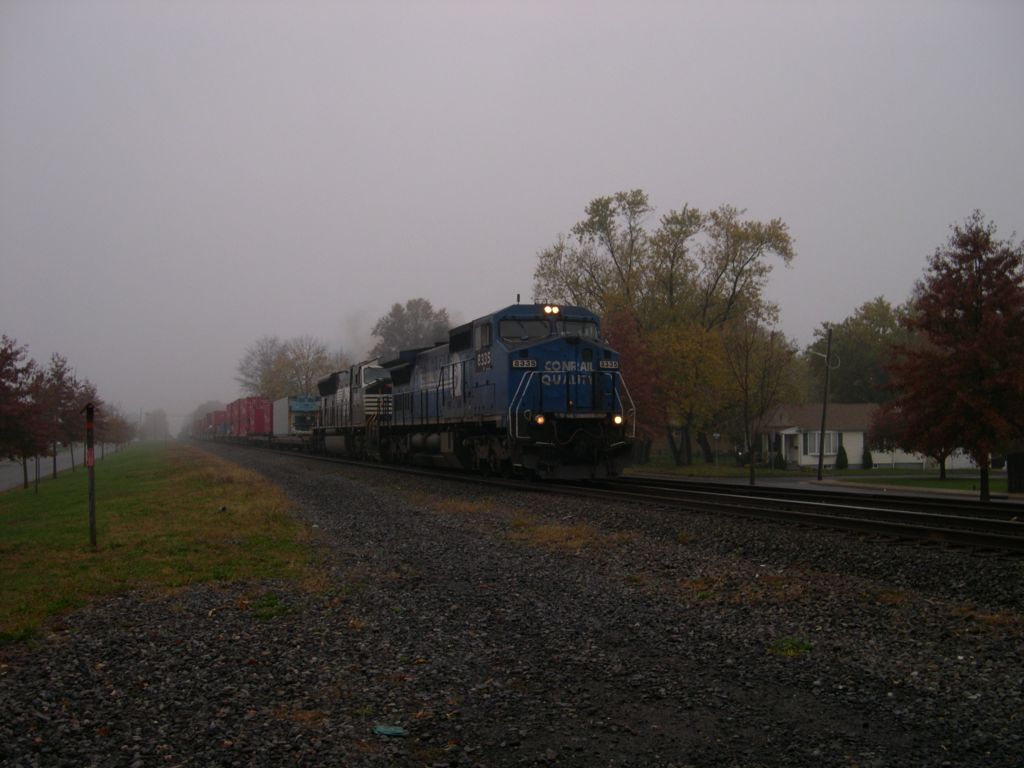 Conrail Quality 8835 Crosses South 13th Street On A Rainy Day