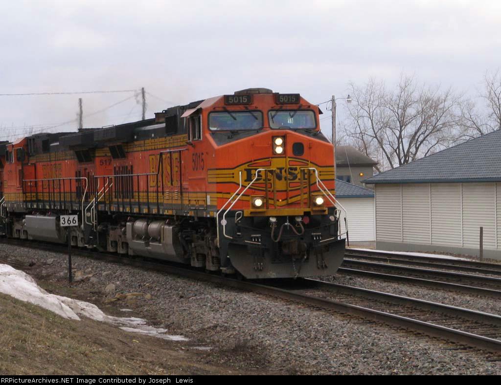 BNSF 5015 WB with empty grain train
