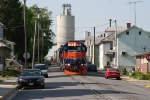 MMID 306 is coming down Farquhar Street with 17 loaded cement hoppers