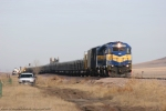 DME 4003 on the point of the loaded railtrain just north of Belle Fourche, SD.