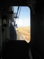 The view from the Conductors side of the DME 4003 on the loaded Railtrain just north of Belle Fourche, SD.