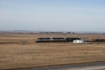 DME 4003 heads up the loaded railtrain just north of Belle Fourche, SD.