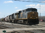 CSX 5315, 8606 & dead KCS 663 lead Q326-19 out of the yard