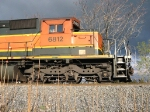 BNSF 6812 and her engineer, both relax in the sun