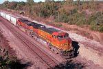 BNSF 5087 pushes westbound  manifest