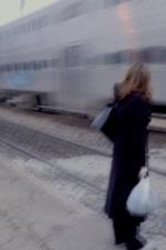 Woman waiting to cross tracks