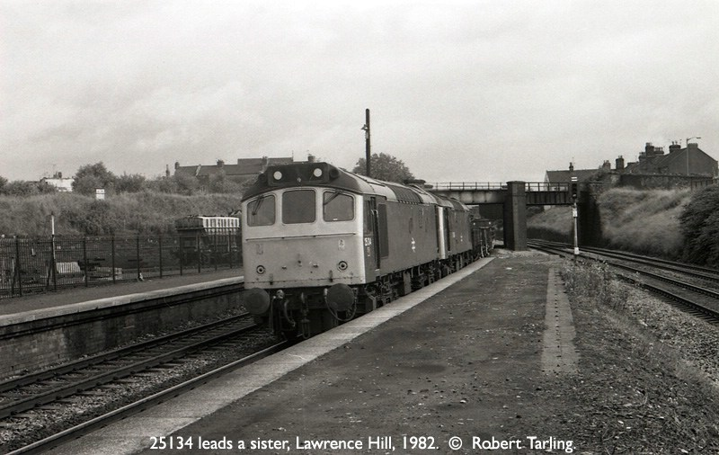 25134 leads another 25 on a down freight, at Lawrence Hill station.