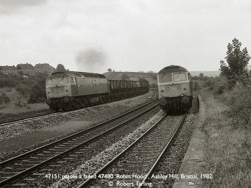 47151 on an Up freight, passes failed 47480 'Robin Hood', on an Up passenger, at the former Ashley Hill station.