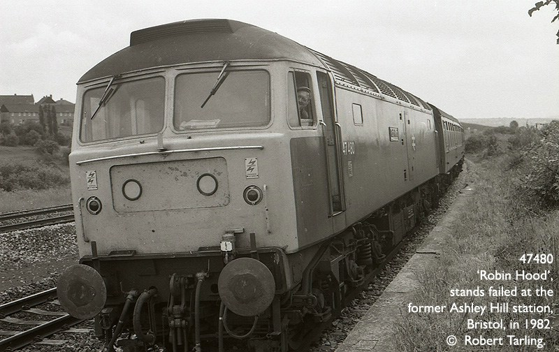 The driver of failed 47480 'Robin Hood' smiles, as the train waits for a banking loco to arrive from Bath Road depot.