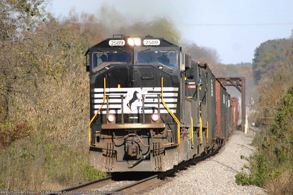 NS 135 with woodchips blowing around