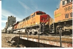 BNSF 6025 rolls in the consist led by BNSF 7793.