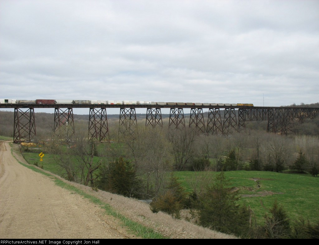 With the coal train led by UP 8048 sitting, the westbound general freight is nearly off the bridge