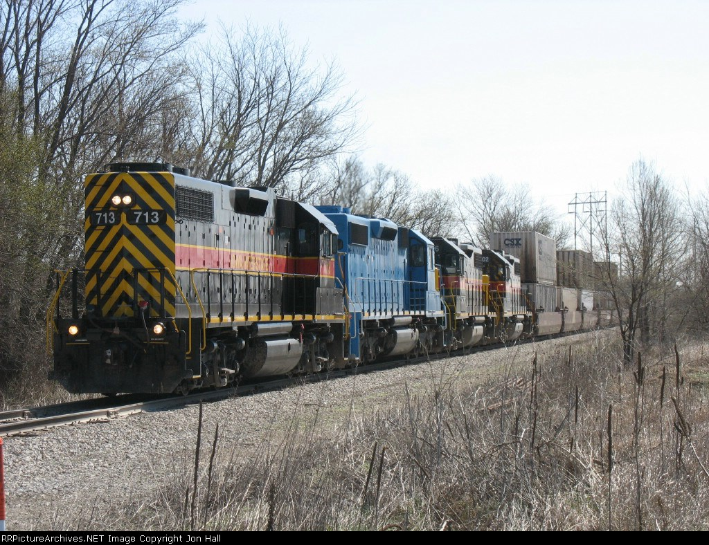 IAIS 713, 154, 706 & 702 leading a train of mostly double stacks westward into town